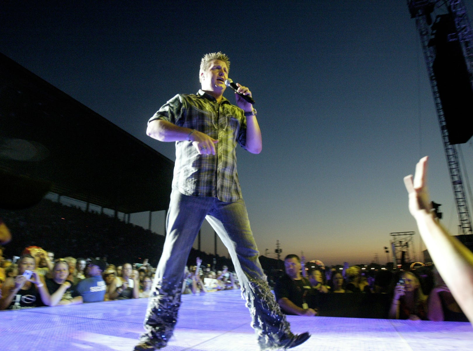 Rascal Flatts vocalist Gary LeVox walks on the catwalk into the crowd at the Rascal Flatts concert at the Grandstand at the 2007 Indiana State Fair Friday August 10.