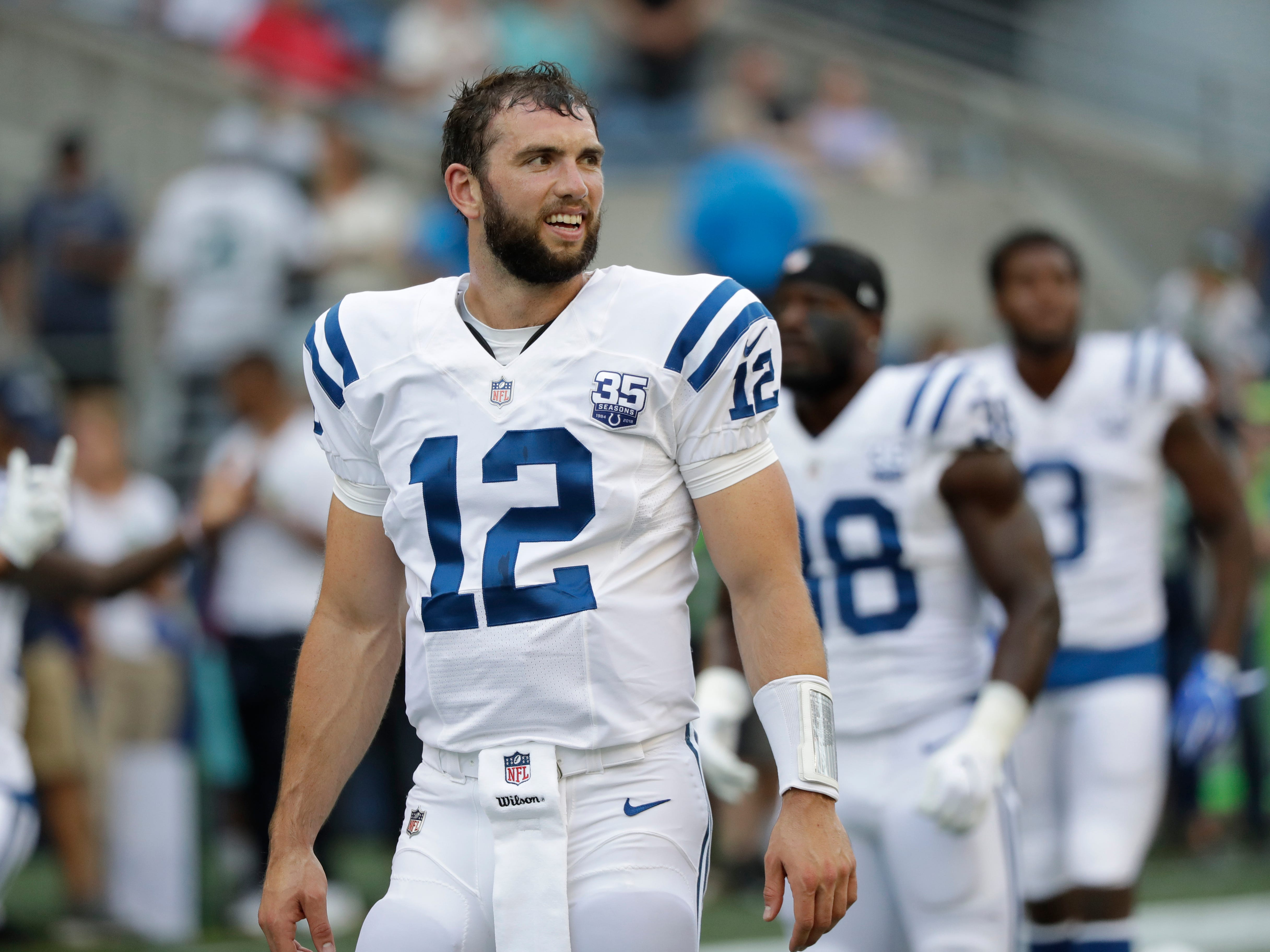 Indianapolis Colts quarterback Andrew Luck stands on the field before an NFL football preseason game against the Seattle Seahawks, Thursday, Aug. 9, 2018, in Seattle. (AP Photo/Elaine Thompson)