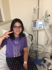 Athena Velasquez of Franklin, Ind. undergoes her last chemotherapy treatment during her more than two year battle with leukemia. Velasquez was diagnosed when she was 11.