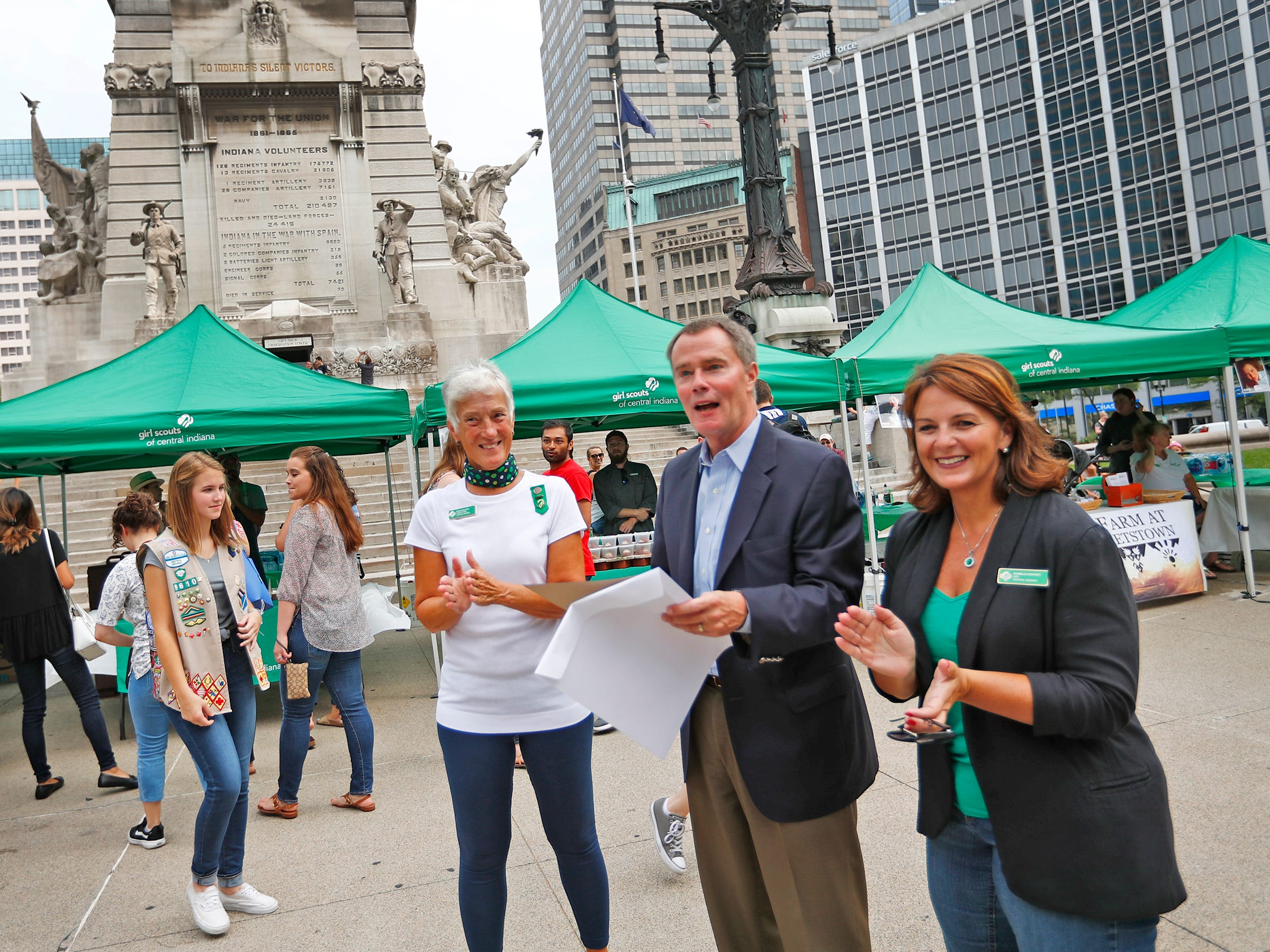 Mayor Joe Hogsett supports Girl Scouts with a proclamation calling Friday, Aug. 10, 2018 as Girl Scouts S'mores on the Circle Day in Indianapolis, during the Girl Scouts' S'mores on the Circle event.  Girl Scouts of Central Indiana Board Chair Diana Sullivan, left, and CEO Danielle Shockey, right, join Hogsett. The event celebrated National S'mores Day.  Seven local chefs were featured, creating gourmet s'mores treats, sold as a fundraiser.  Proceeds go for financial assistance for Girl Scouts, helping all girls who want to be a girl scout participating in hands-on adventures and STEM activities.