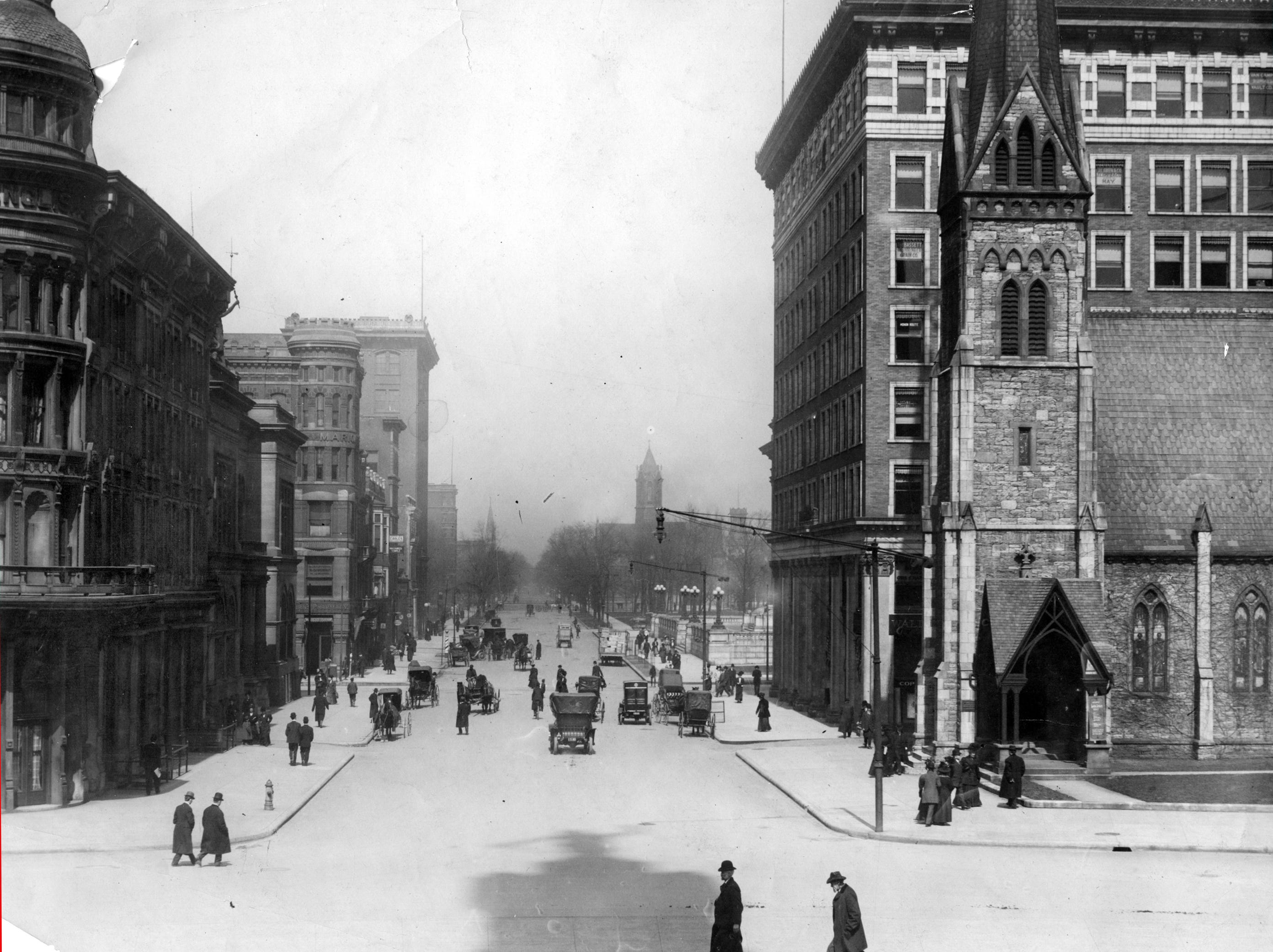 The Soldier's and Sailor's Monument casts a shadow pointing north of Meridian Street.  Christ Church Cathedral to the right with the Board of Trade building behind it and the English Hotel to the left.  Date unknown.