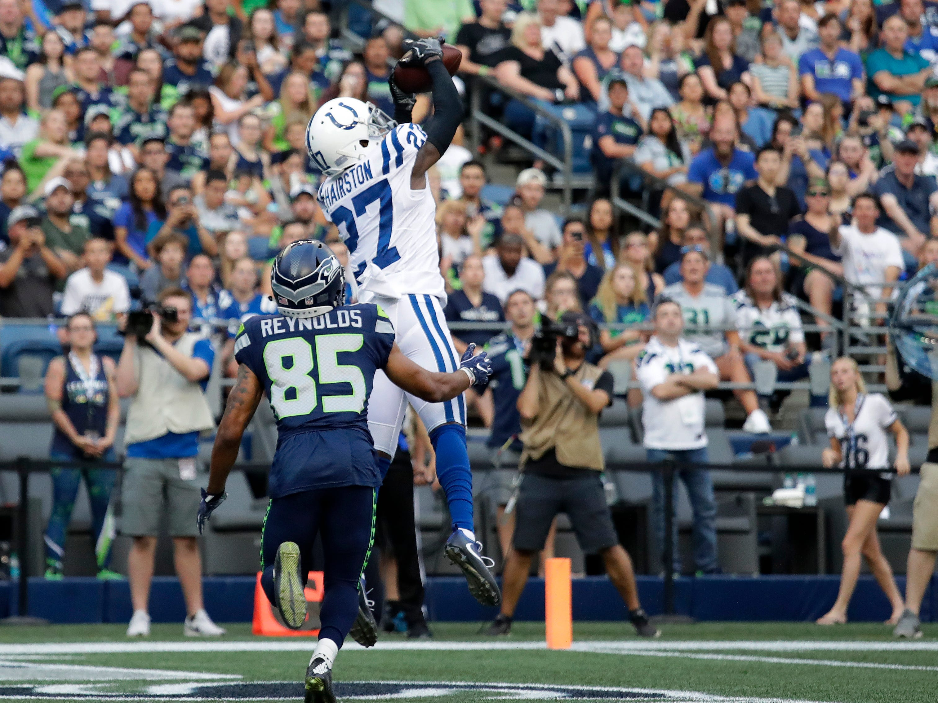 Indianapolis Colts cornerback Nate Hairston (27) intercepts a pass intended for Seattle Seahawks wide receiver Keenan Reynolds (85) during the first half of an NFL football preseason game, Thursday, Aug. 9, 2018, in Seattle. (AP Photo/Elaine Thompson)