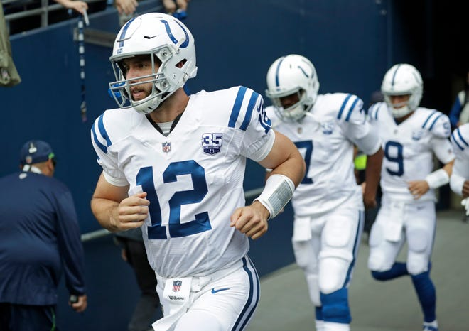 Indianapolis Colts quarterback Andrew Luck (12) takes the field for warmups before an NFL football preseason game against the Seattle Seahawks, Thursday, Aug. 9, 2018, in Seattle. (AP Photo/Stephen Brashear)