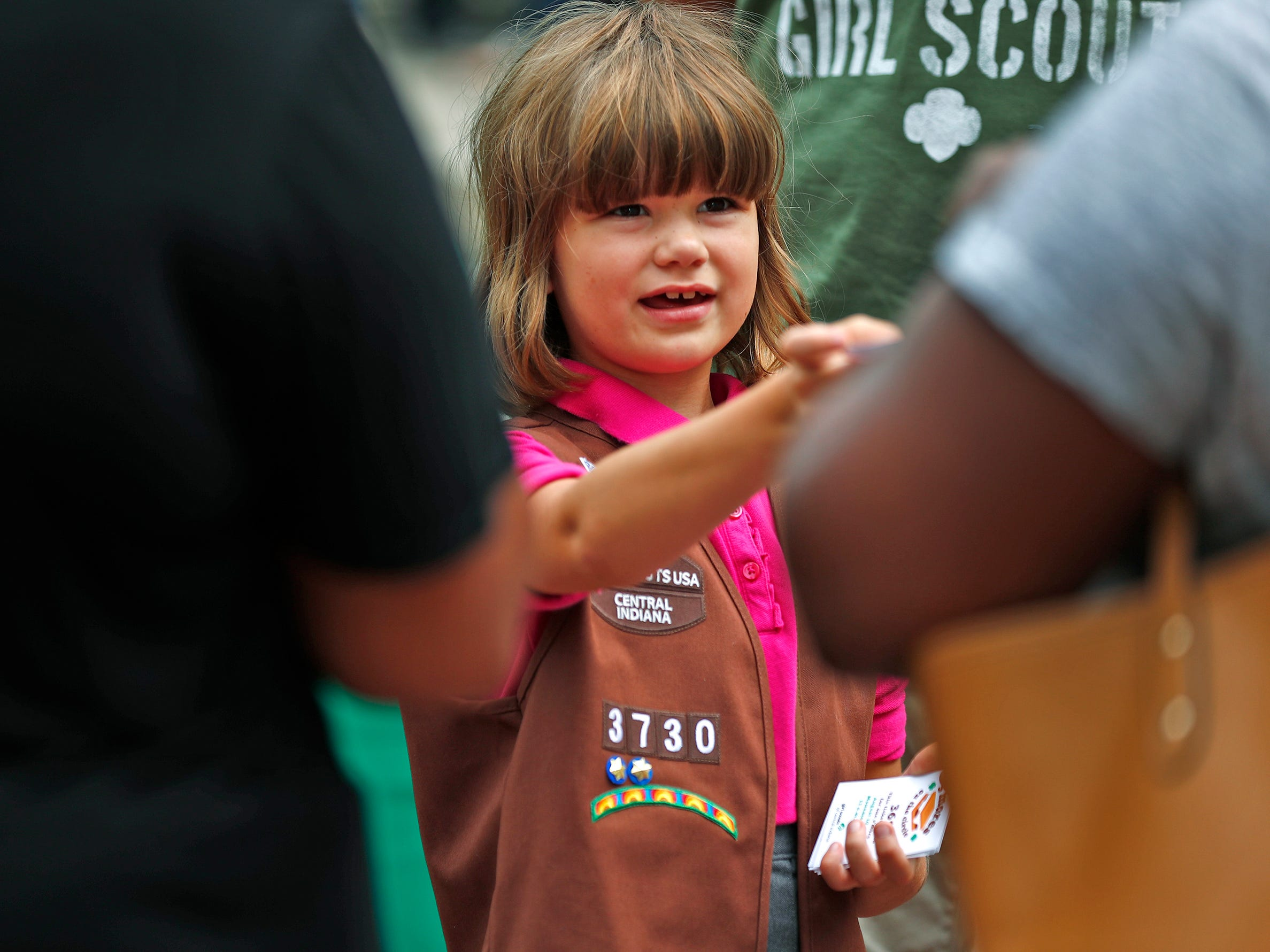 Marian McConnell hands out tickets for s'mores during the Girl Scouts' S'mores on the Circle event, Friday, Aug. 10, 2018.  The event celebrated National S'mores Day.  Seven local chefs were featured, creating gourmet s'mores treats, sold as a fundraiser.  Proceeds go for financial assistance for Girl Scouts, helping all girls who want to be a girl scout participating in hands-on adventures and STEM activities.