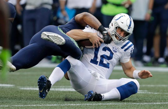 Indianapolis Colts quarterback Andrew Luck (12) is tackled by Seattle Seahawks linebacker Bobby Wagner during the first half of an NFL football preseason game, Thursday, Aug. 9, 2018, in Seattle. (AP Photo/Stephen Brashear)