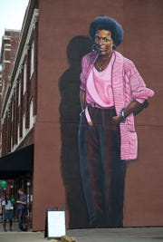 The mural depicting poet Mari Evans stands on Mass Ave. It was painted by artist Michael Alkemi Jordan.
