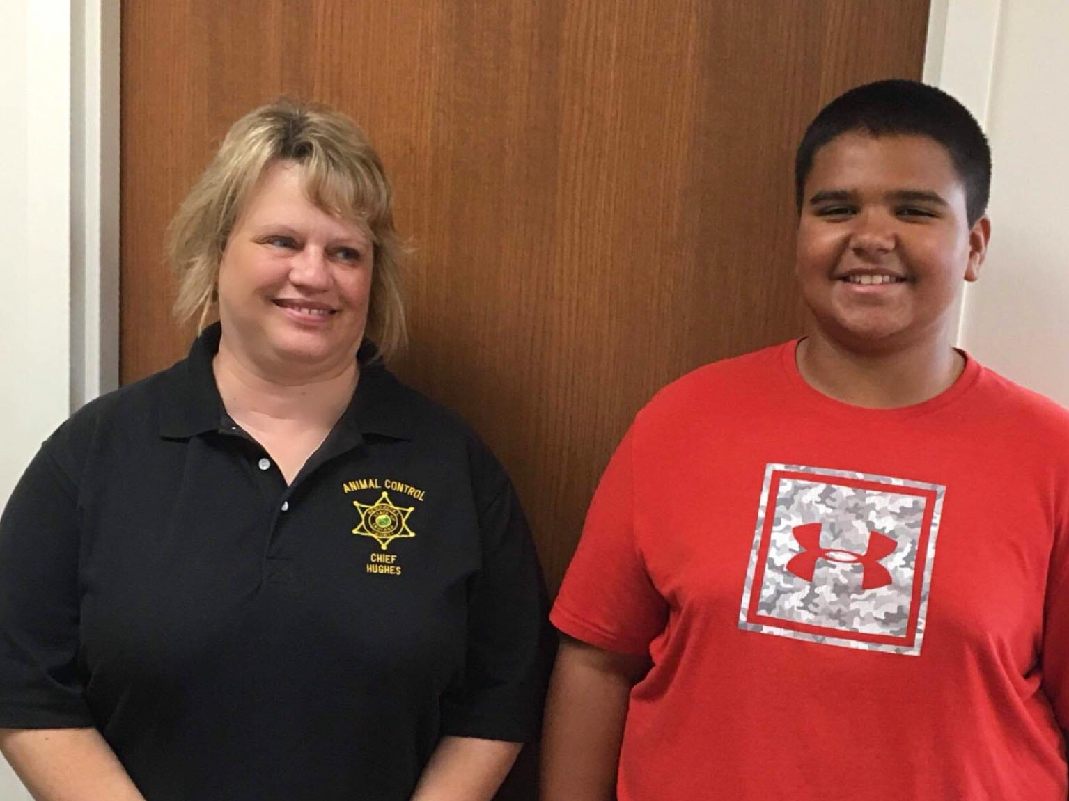 Hendricks County Animal Control Shelter chief director LaDonna Hughes accepted the $100 donation Anthony Goines gave the shelter from his 13th birthday.