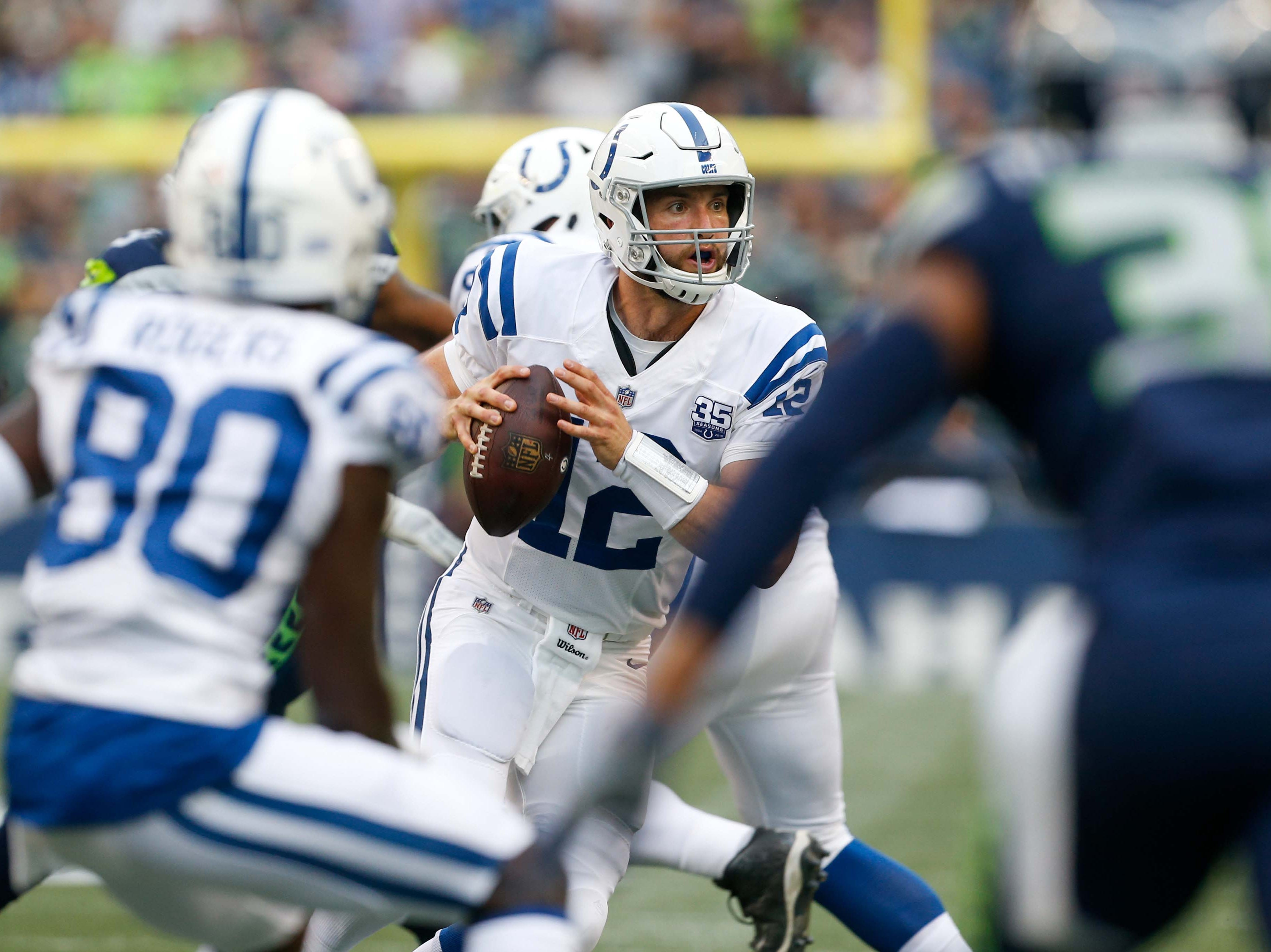 Indianapolis Colts quarterback Andrew Luck (12) looks to pass against the Seattle Seahawks during the first quarter at CenturyLink Field.