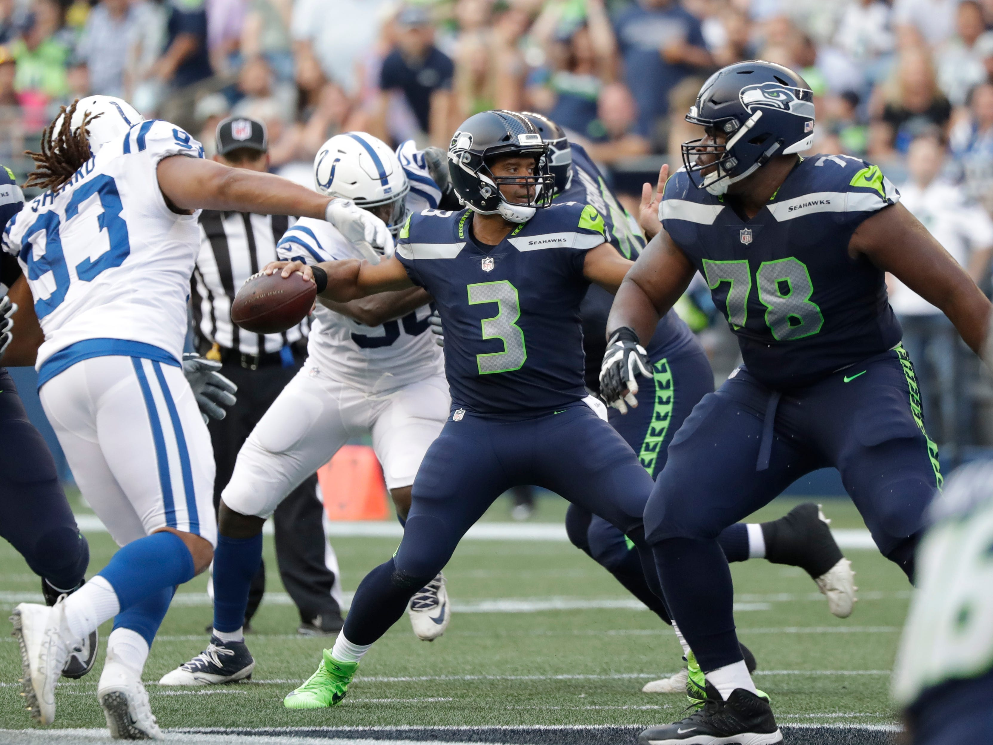 Seattle Seahawks quarterback Russell Wilson (3) passes against the Indianapolis Colts during the first half of an NFL football preseason game, Thursday, Aug. 9, 2018, in Seattle. (AP Photo/Elaine Thompson)