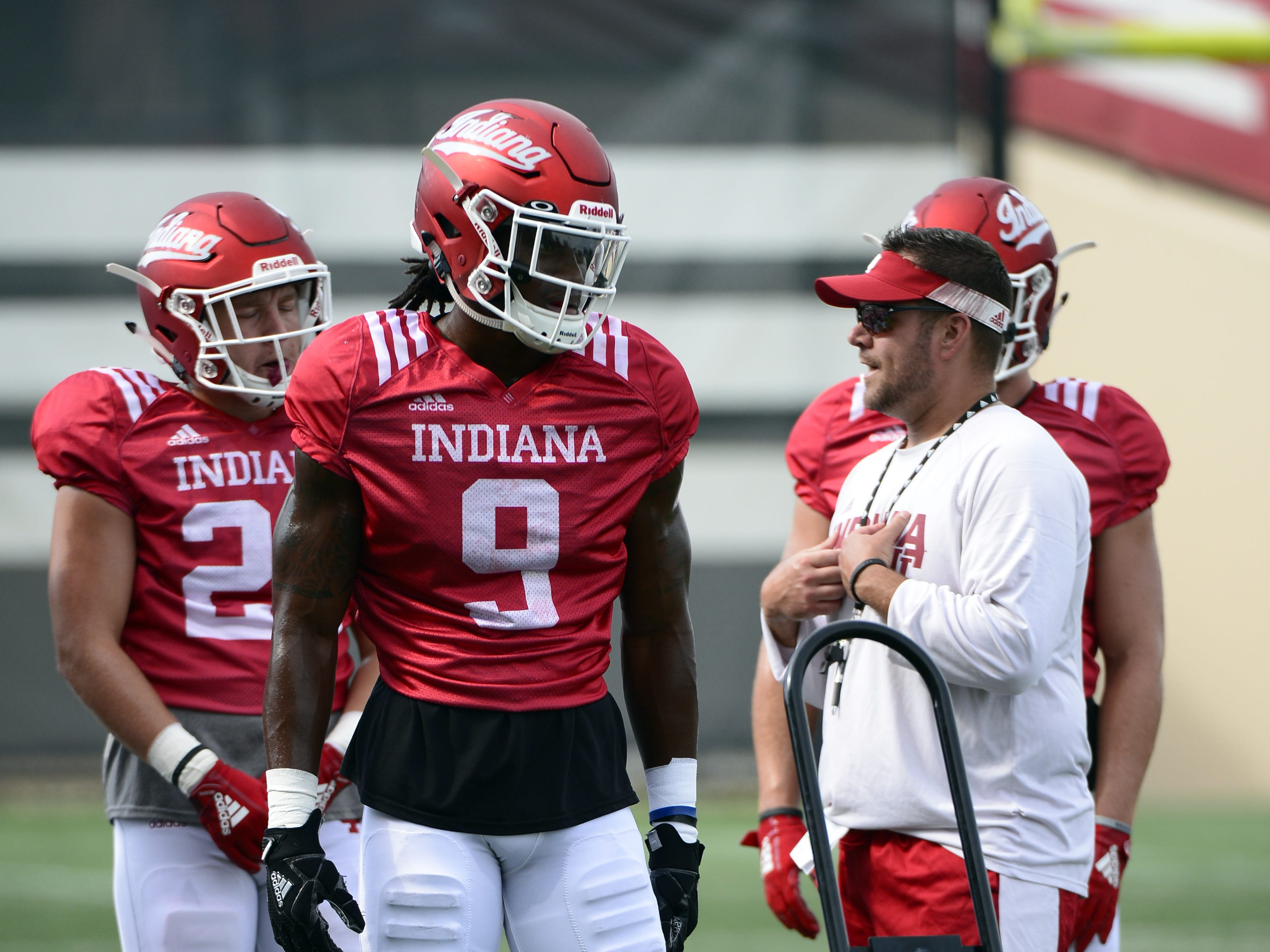 Indiana Hoosiers defensive back Jonathan Crawford (9) talks to his coach during practice at Mellencamp Pavilion in Bloomington, Ind., on Friday, August 10, 2018.