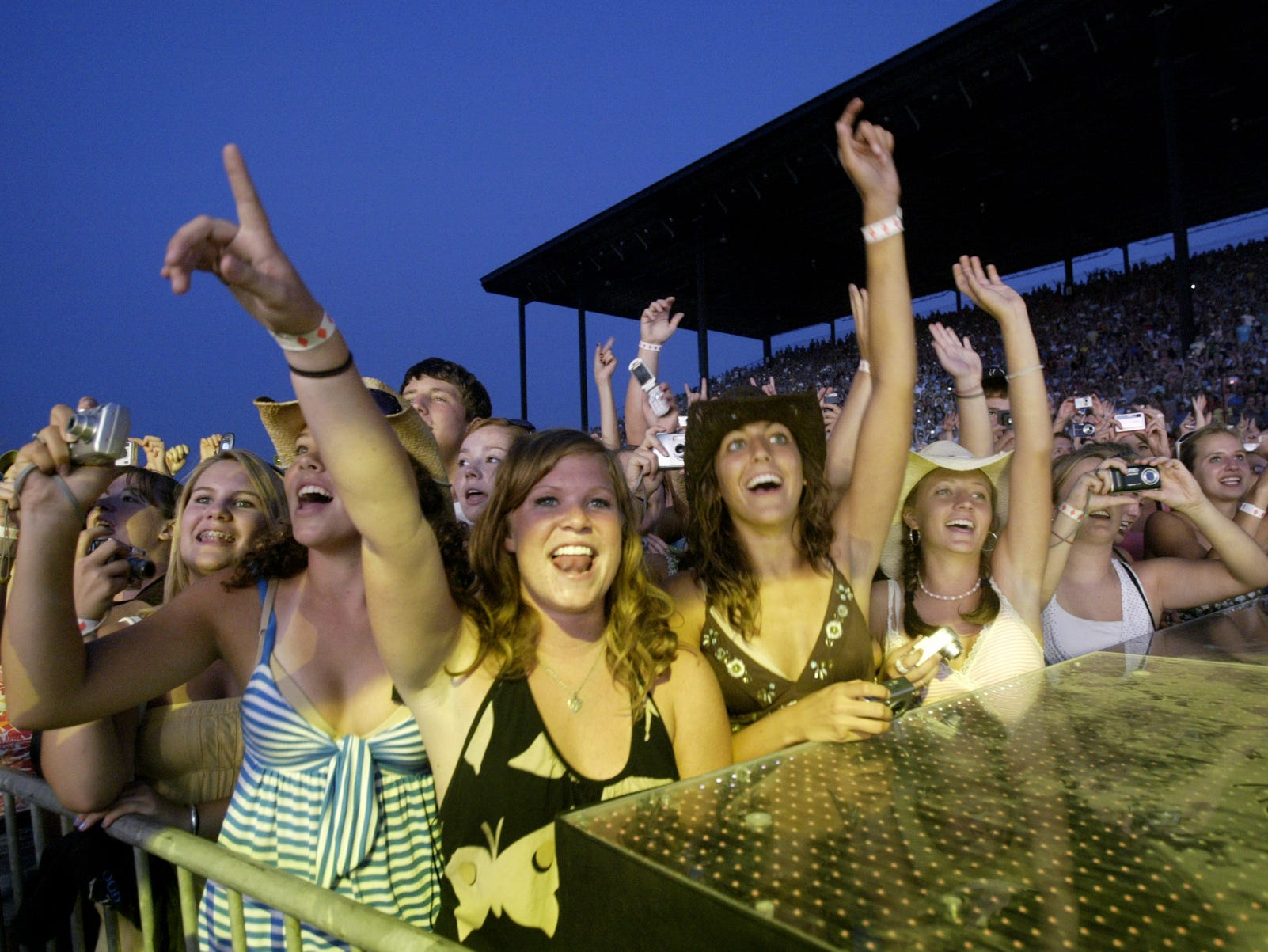 A group of fans from Hamilton Southeastern High School in Fishers cheer for Rascal Flatts  at the Rascal Flatts concert at the Grandstand at the 2007 Indiana State Fair Friday August 10.