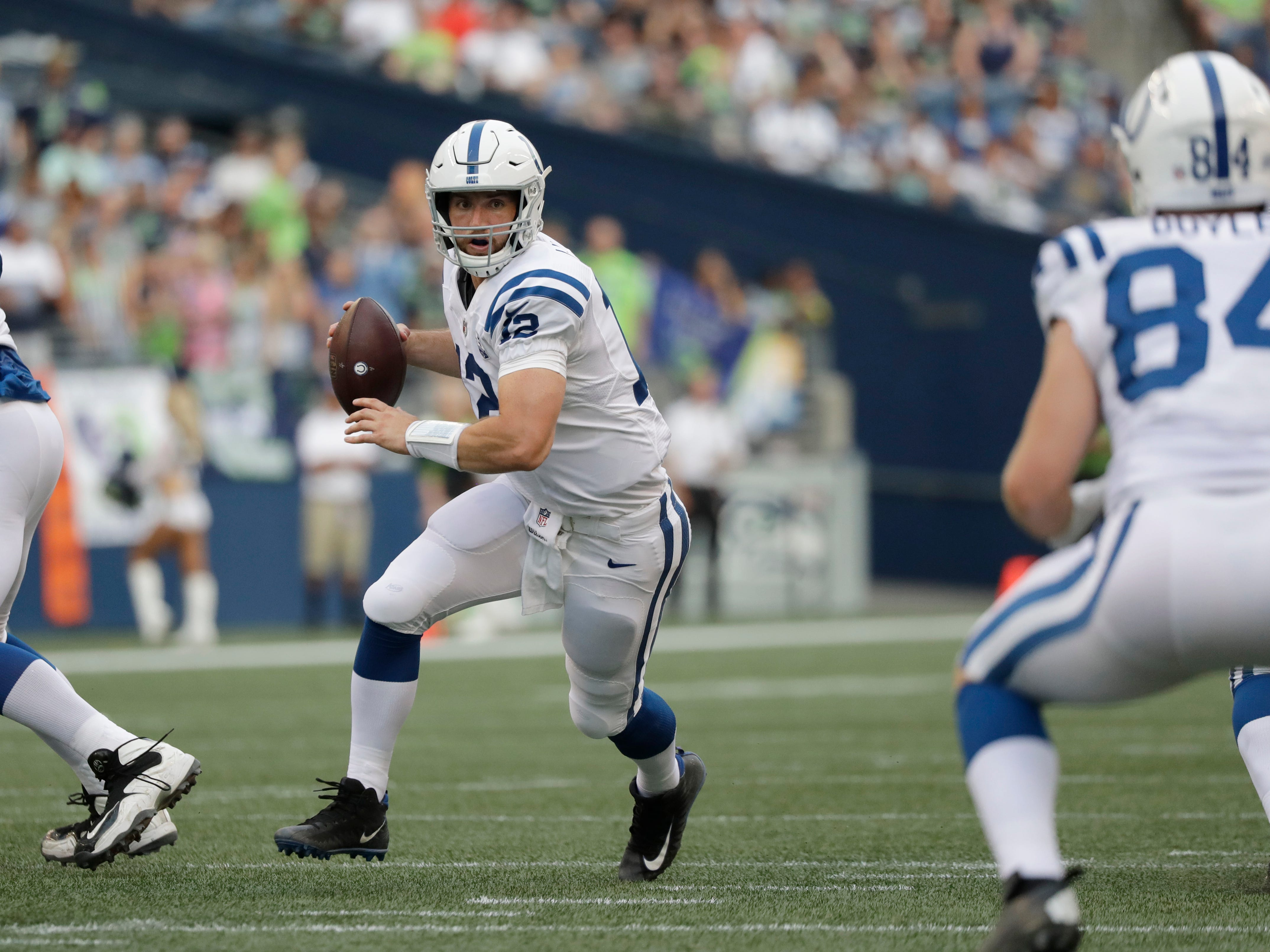 Indianapolis Colts quarterback Andrew Luck scrambles with the ball against the Seattle Seahawks during the first half of an NFL football preseason game, Thursday, Aug. 9, 2018, in Seattle. (AP Photo/Elaine Thompson)