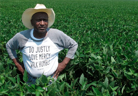 In this Wednesday, June 25, 2018 photo, David Allen Hall poses for a photo in his soybean field, in Parchman, Miss. Hall is a farmer who is suing a seed company, alleging he was sold faulty soybean seeds because of his race. The company denies the allegations. (AP Photo/Adrian Sainz)