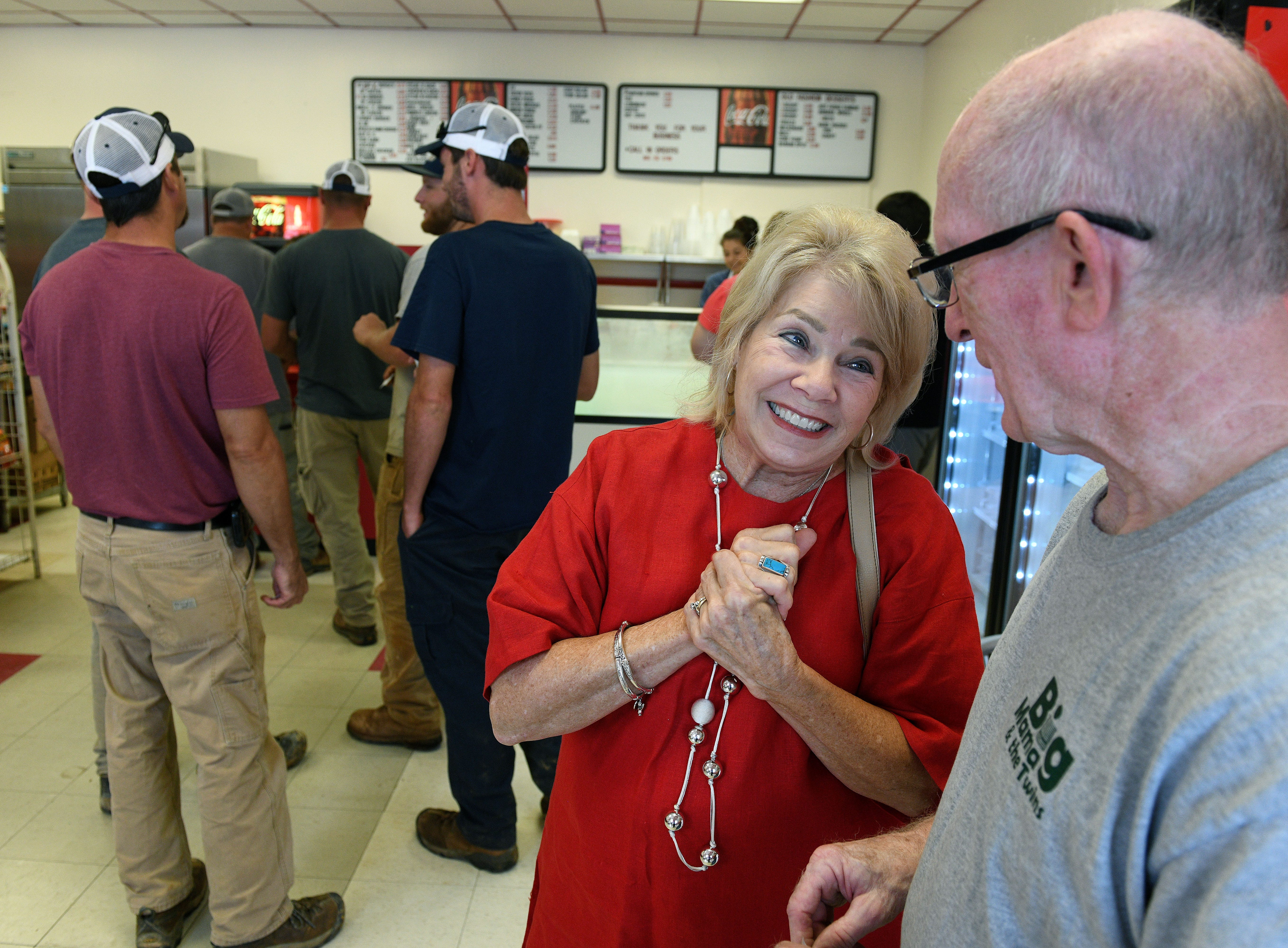 Sharon Wallace Cameron and Dennis Wester, members of the South High School Class of 1965, talk while waiting in line at the newly opened Scotts, in the old Kay's Ice Cream building, Friday, August 10, 2018.