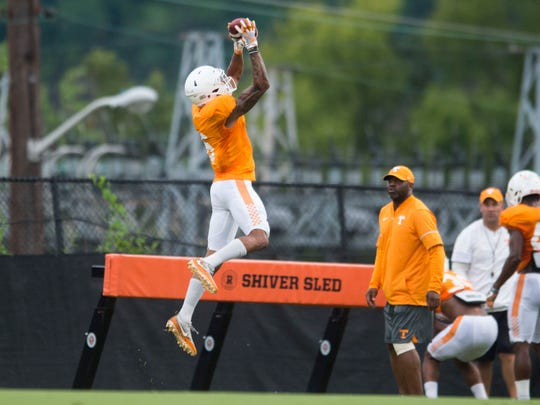 Tennessee defensive back and wide receiver Alontae Taylor    on a leaping catch during football practice at Haslam Field on Thursday, August 9, 2018.