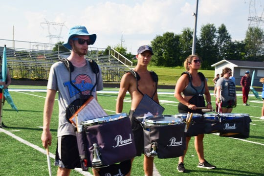 The Karns High marching band drum line runs through drills during a recent band camp.