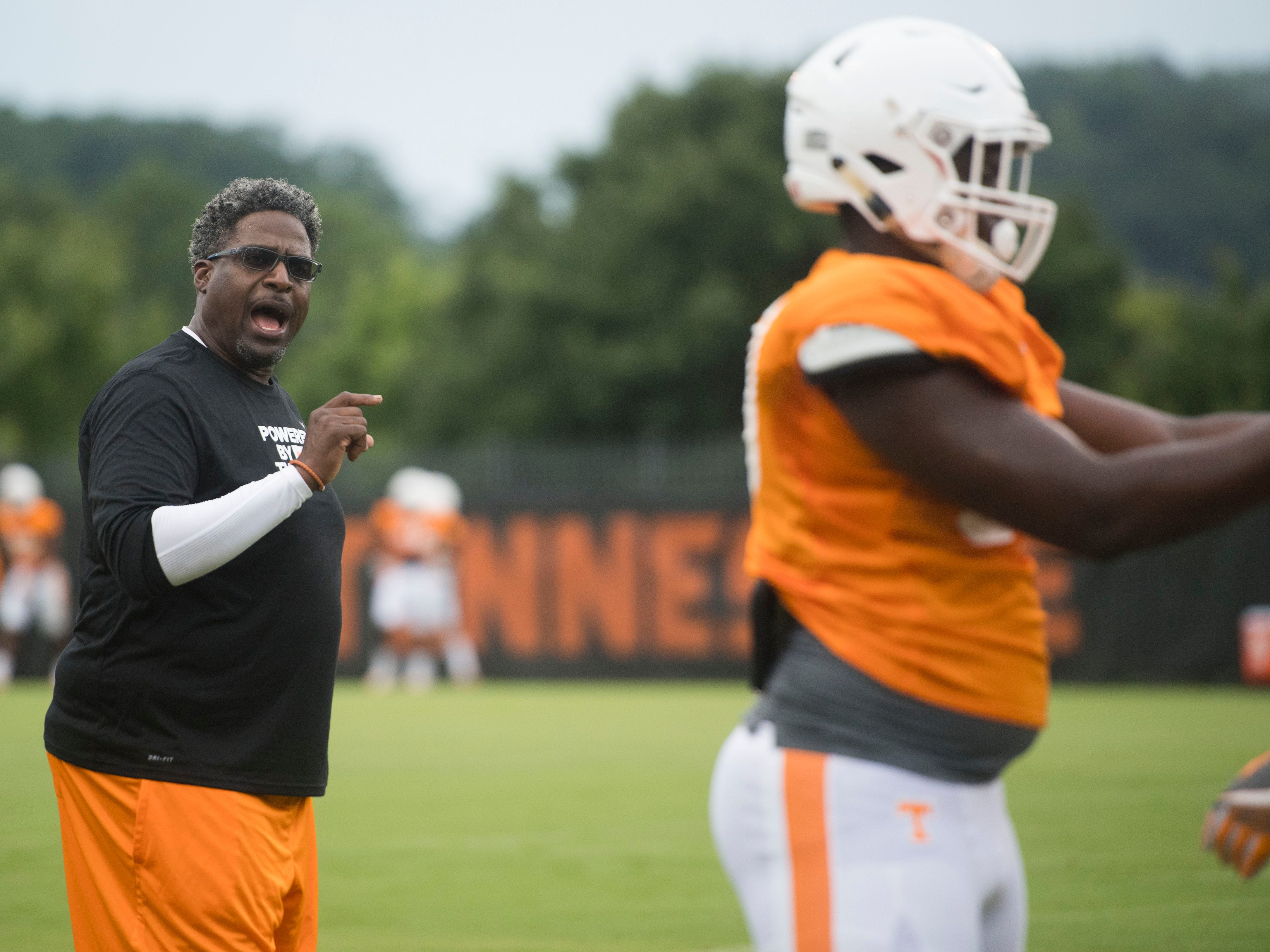 Tennessee defensive line coach Tracy Rocker drill his players during football practice at Haslam Field on Thursday, August 9, 2018.
