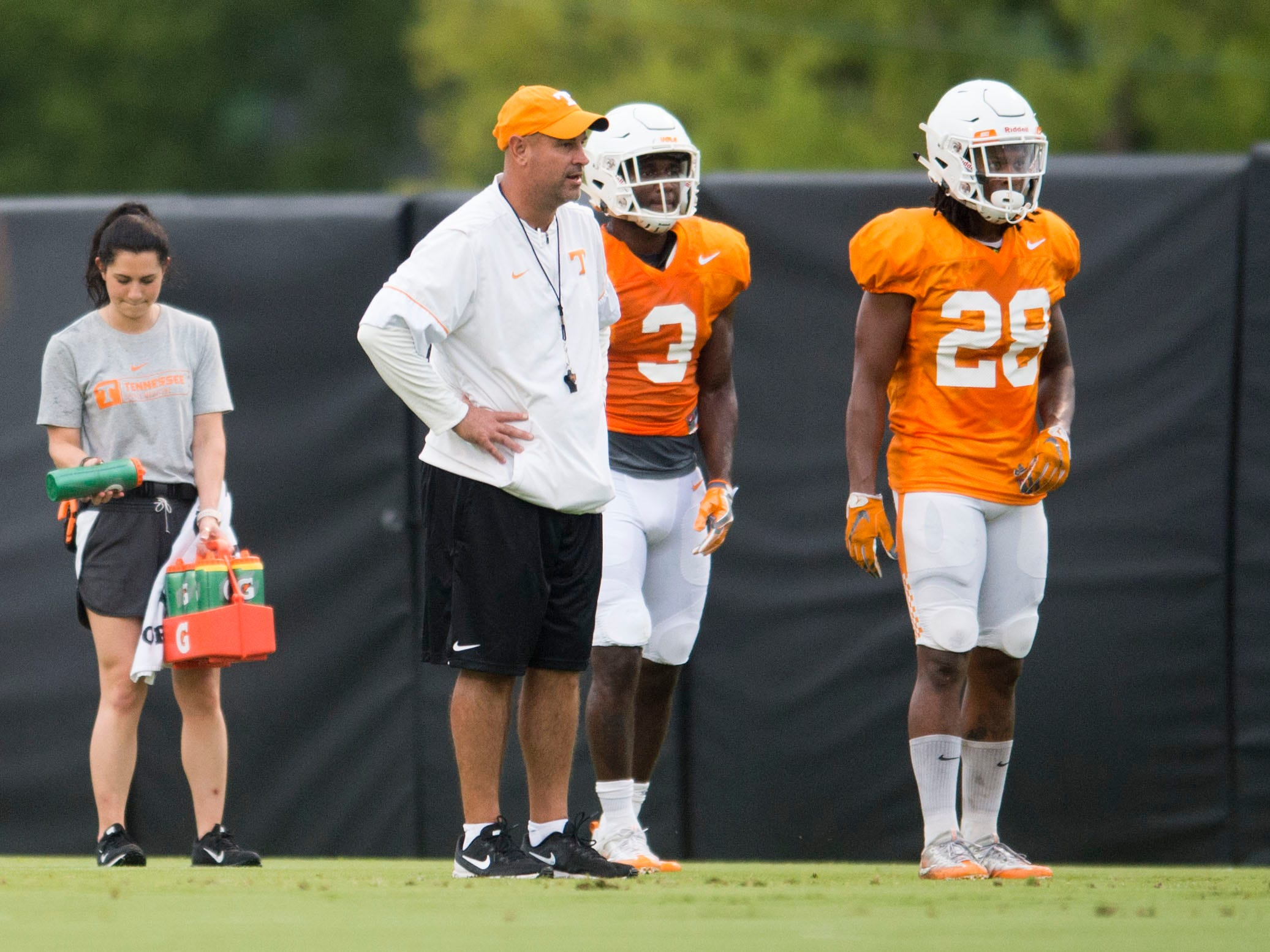 Tennessee head coach Jeremy Pruitt with defensive back Marquill Osborne, left, Baylen Buchanan during football practice at Haslam Field on Thursday, August 9, 2018.