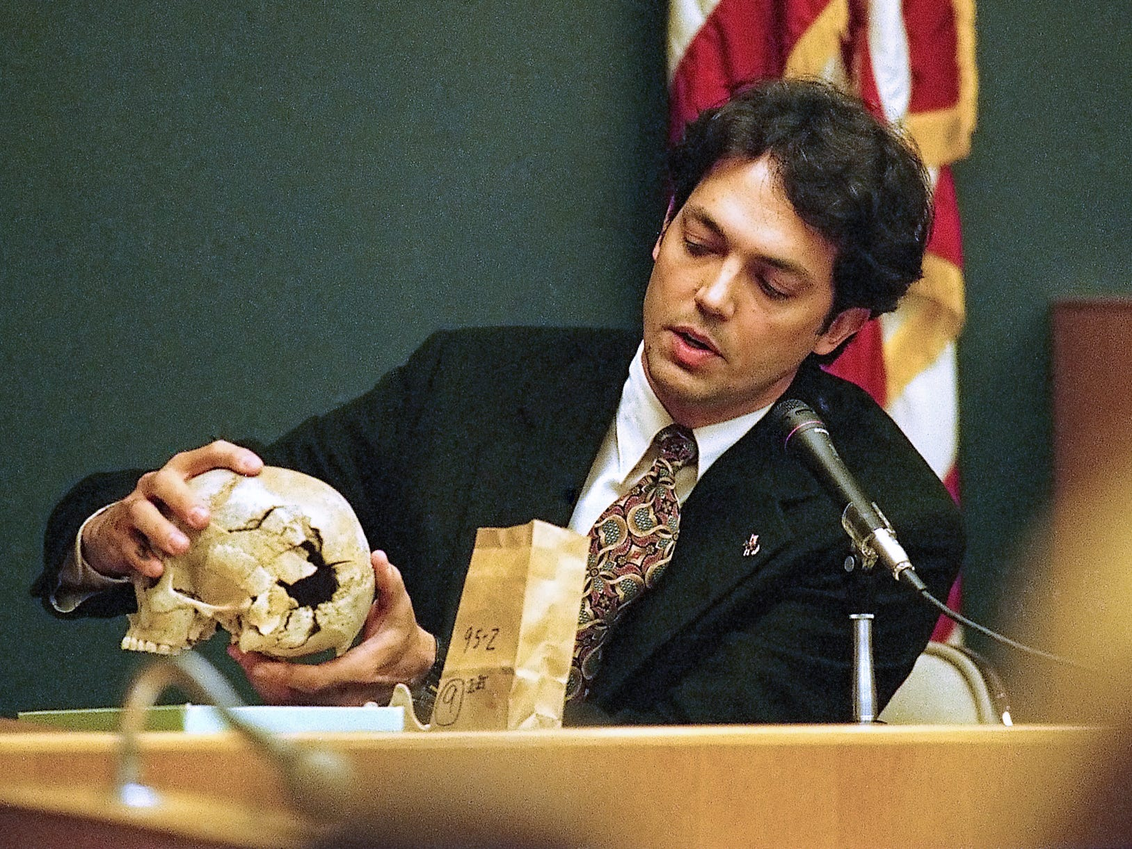 University of Tennessee forensic anthropologist Dr. Murray Marks testifies about the wounds to Colleen A. Slemmer's skull during Christa Gail Pike's murder trial in Knox County Criminal Court on March 25, 1996.