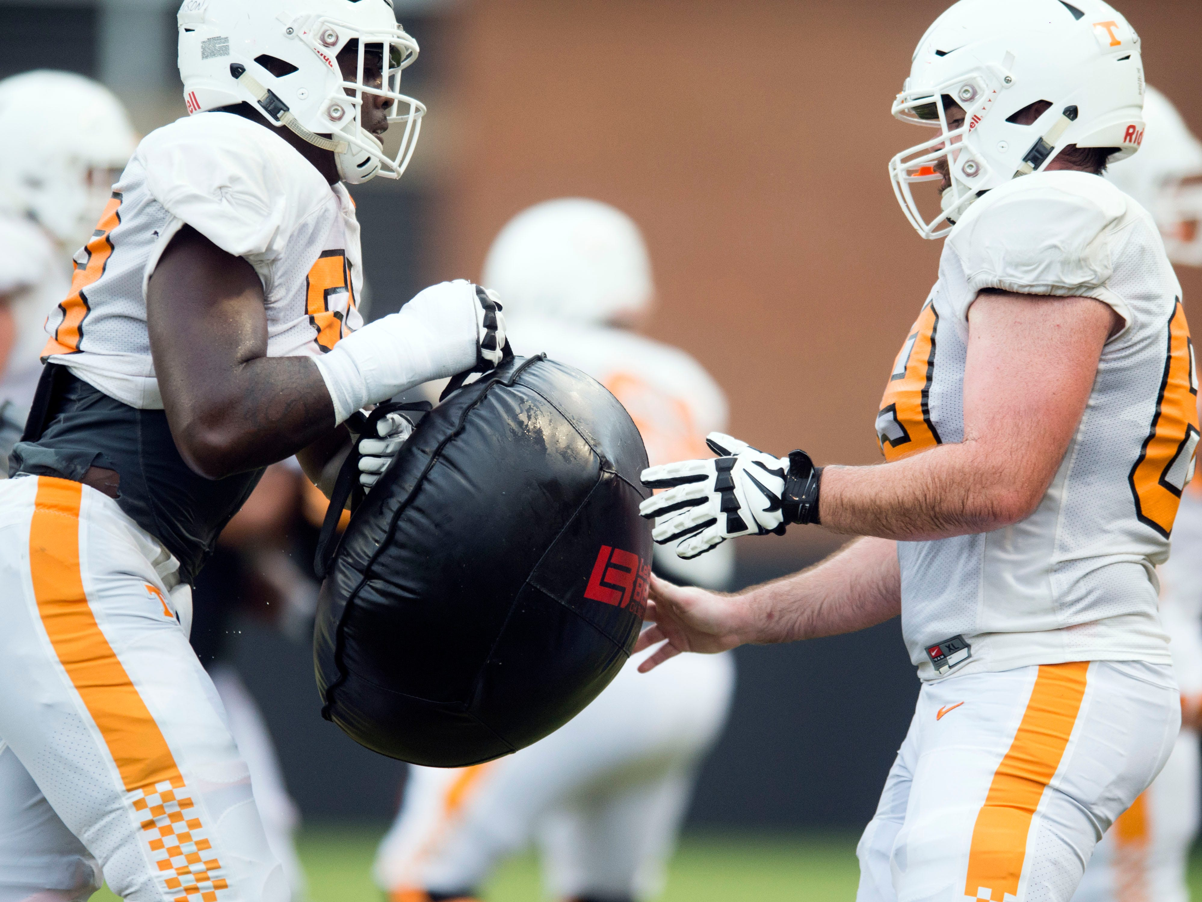 Tennessee offensive lineman Jahmir Johnson, left, and  Brian Garvey drill together at football practice on Thursday, August 9, 2018.