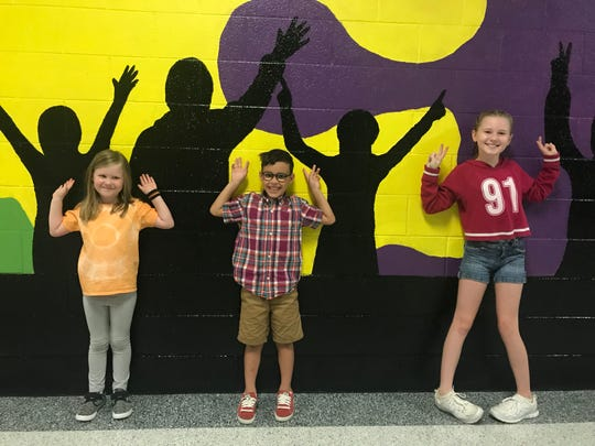 Joining in a concert mob are students Lyric , Oliver and Nimueh at Dogwood Elementary School. August 2018