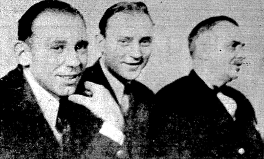 Frank Hopson (left) and Gus McCoig smile during the Hutchinson murder trial in Maynardville on Feb. 26, 1936. At right is deputy sheriff George Hunter of Knox County.