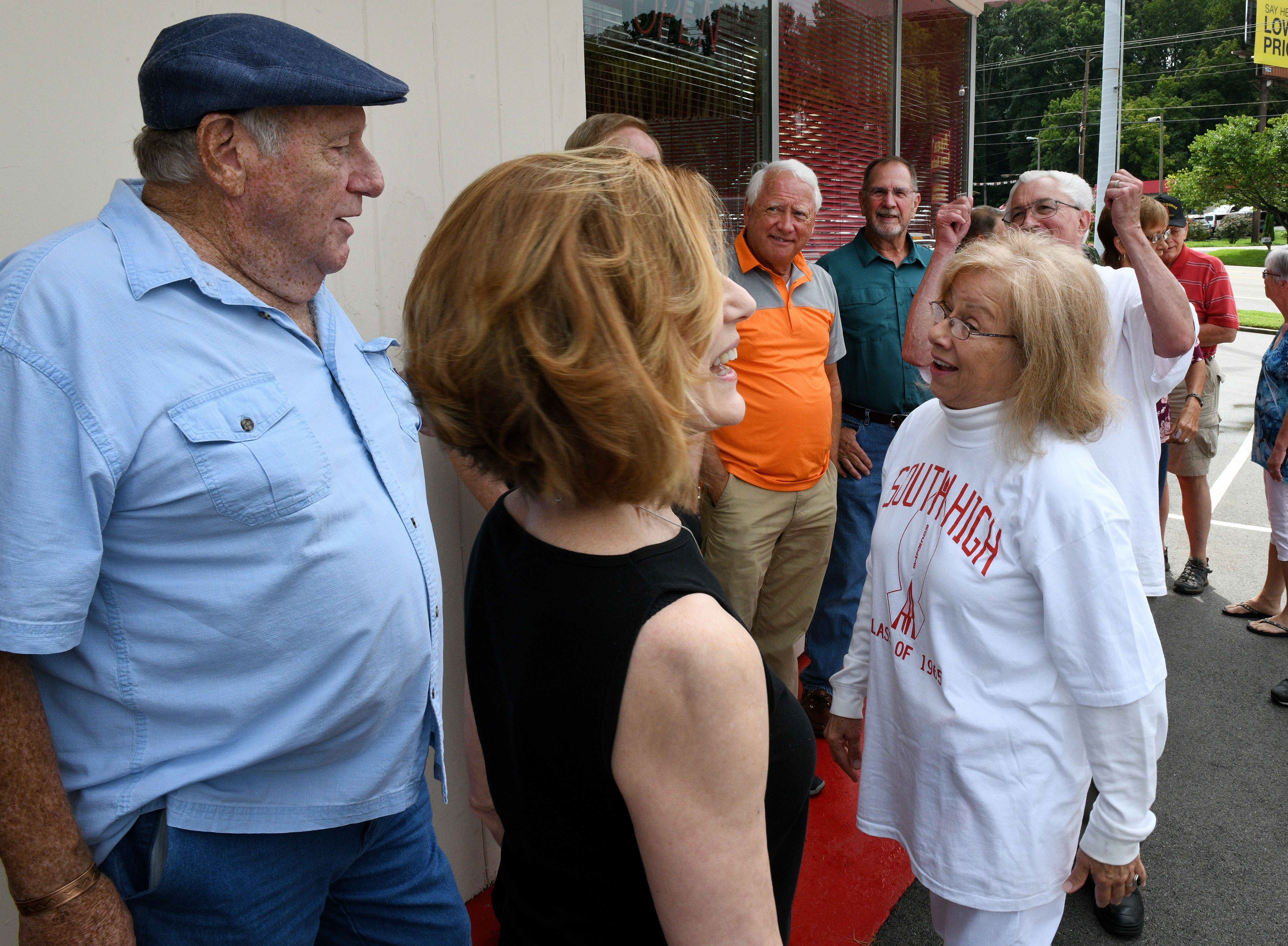 Members of the South High School Class of 1965 gathered outside the newly opened Scotts, in the old Kay's Ice Cream building, waiting for them to open Friday, August 10, 2018.