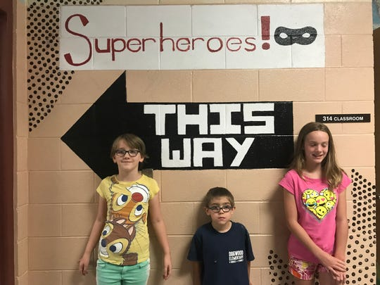 The Berry Family (Hayley, Elijah and  Ahni) are trying to figure out which way superheroes should go at Dogwood Elementary School. August 2018