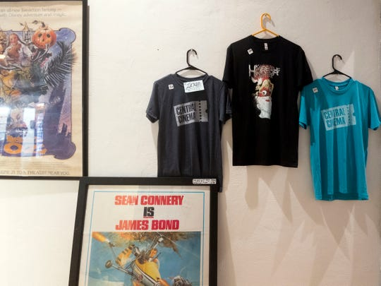 T-shirts and movie posters decorate the walls at Central Cinema on Thursday, Aug. 9, 2018.