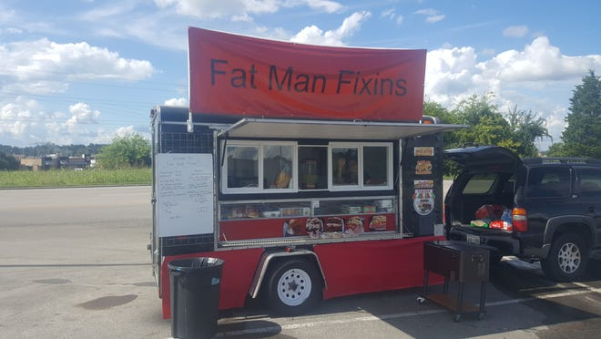 The fully decked out food truck of Fat Man Fixins. August 2018