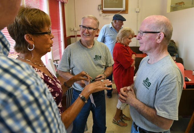 Members of the South High School Class of 1965, Cecilia Houser, left, and Dennis and David Wester, gathered at the newly opened Scotts, in the old Kay's Ice Cream building,  Friday, August 10, 2018.