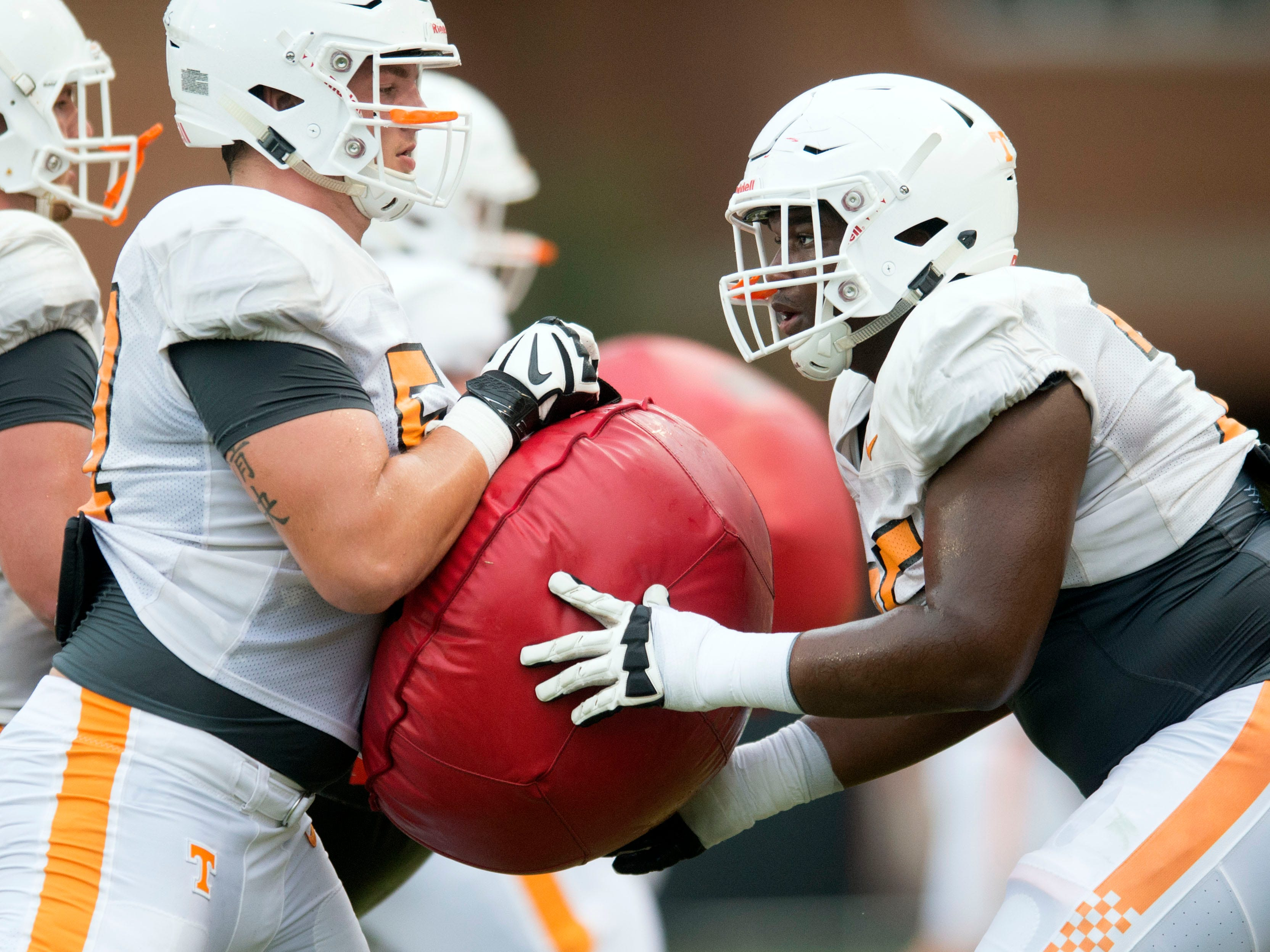 Tennessee offensive linemen Nathan Niehaus, left, and Jerome Carvin drill together during football practice at Haslam Field on Thursday, August 9, 2018.