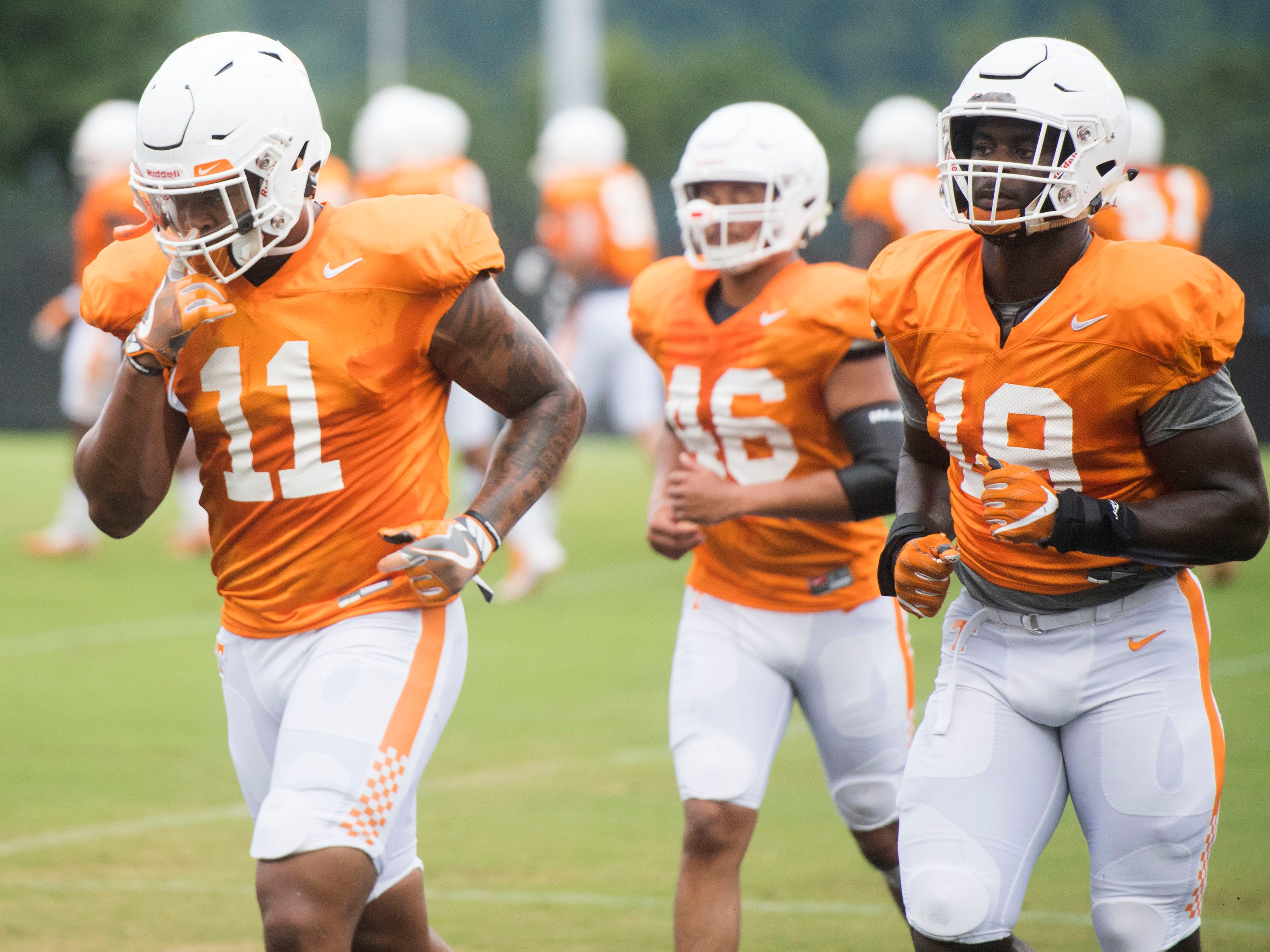 Tennessee linebackers, from left, Austin Smith, Joshua Warren, and Darrell Taylor during football practice at Haslam Field on Thursday, August 9, 2018.