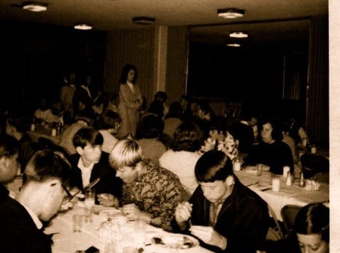 The South High School band enjoying a meal on a band trip in 1967.