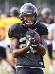 Running back Evan Anderson with a carry during Purdue football practice Friday, August 10, 2018, in West Lafayette.