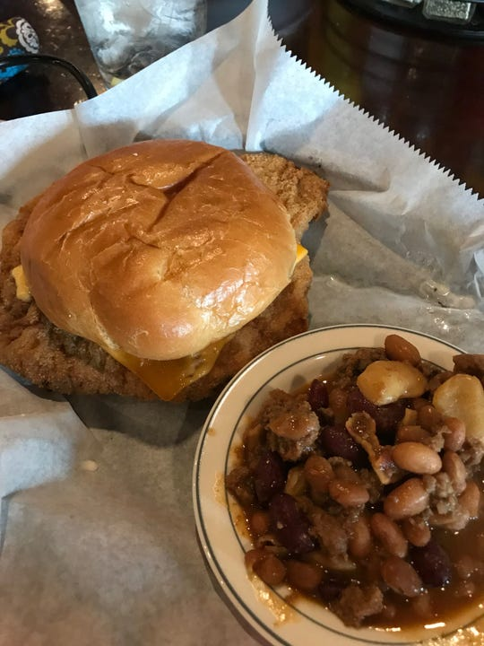 Tuesday's special at The Old Buffalo's Outpost Bar & Grill, a breaded tenderloin with cowboy beans.