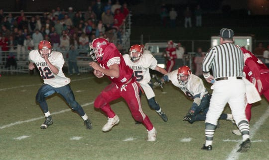 West Lafayette's Chike Okeafor with a 47-yard touchdown run in a 1993 game.