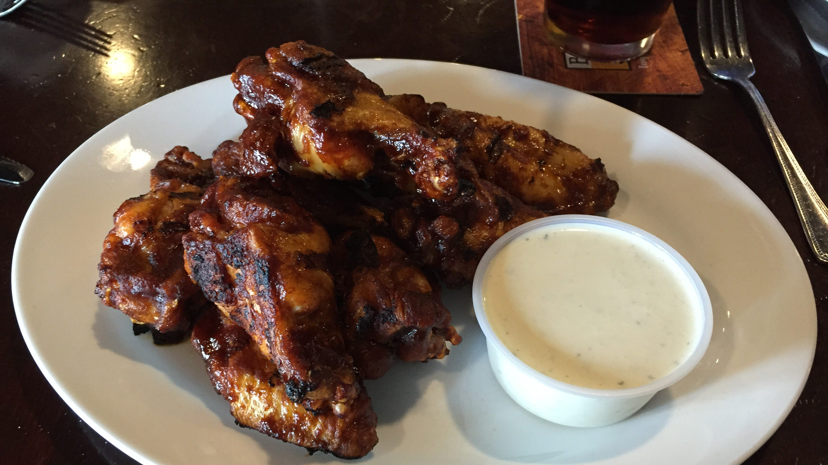 The OBO wings, char buffed and finished on the grill, can be a satisfying meal or an appetizer.