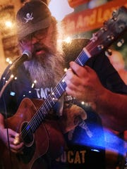 Eric Peacock, a regular at open mic nights in Lafayette, was killed when a hit-and-run driver struck him, his friend, Kiimberly McDole and tow truck driver Robert Carley the morning of Aug. 1 on U.S. 52 near Indiana 28.