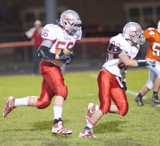 West Lafayette's Dayton Snyder returns an interception for a touchdown against Hamilton Heights.