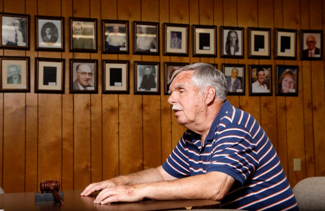 Jack Weidner talks about his 34 years as mayor of Pleasantville Thursday afternoon, Aug. 10, 2018, in Pleasantville Council Chambers. On the wall behind Weidner are photographs of his mayoral predecessors. Weidner retired from office in June.