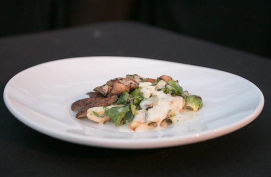 Chef Craig Myrand's grilled chicken thighs, roasted Brussels sprouts, Portobello mushrooms and gnocchi in a blue cheese cream sauce won him the Gleaners Iron Chef Competition Thursday, Aug. 9, 2018.