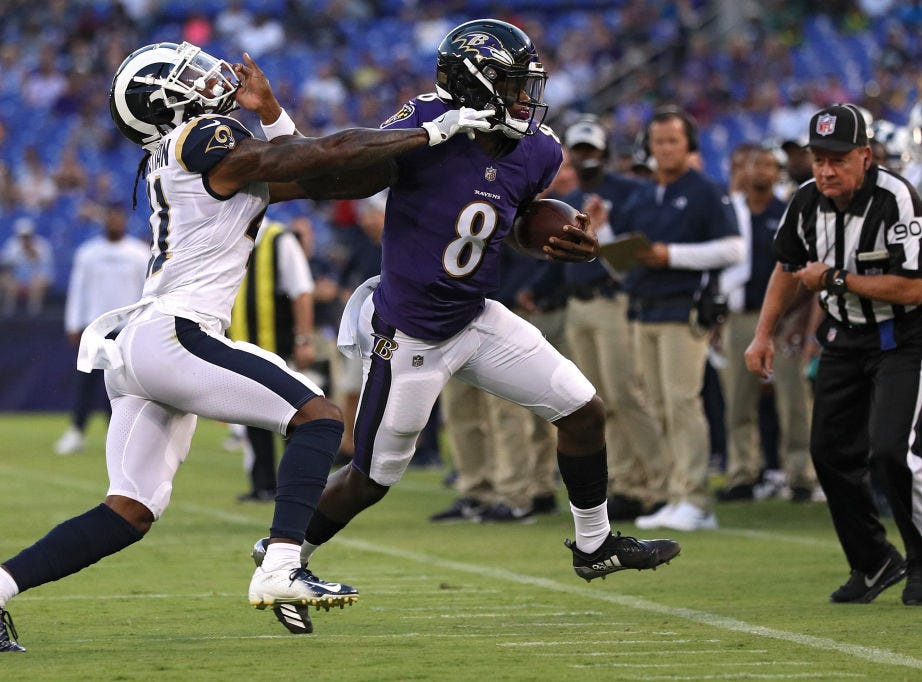 BALTIMORE, MD - AUGUST 09: Lamar Jackson #8 of the Baltimore Ravens rushes past Marqui Christian #41 of the Los Angeles Rams during a preseason game at M&T Bank Stadium on August 9, 2018 in Baltimore, Maryland. (Photo by Patrick Smith/Getty Images)