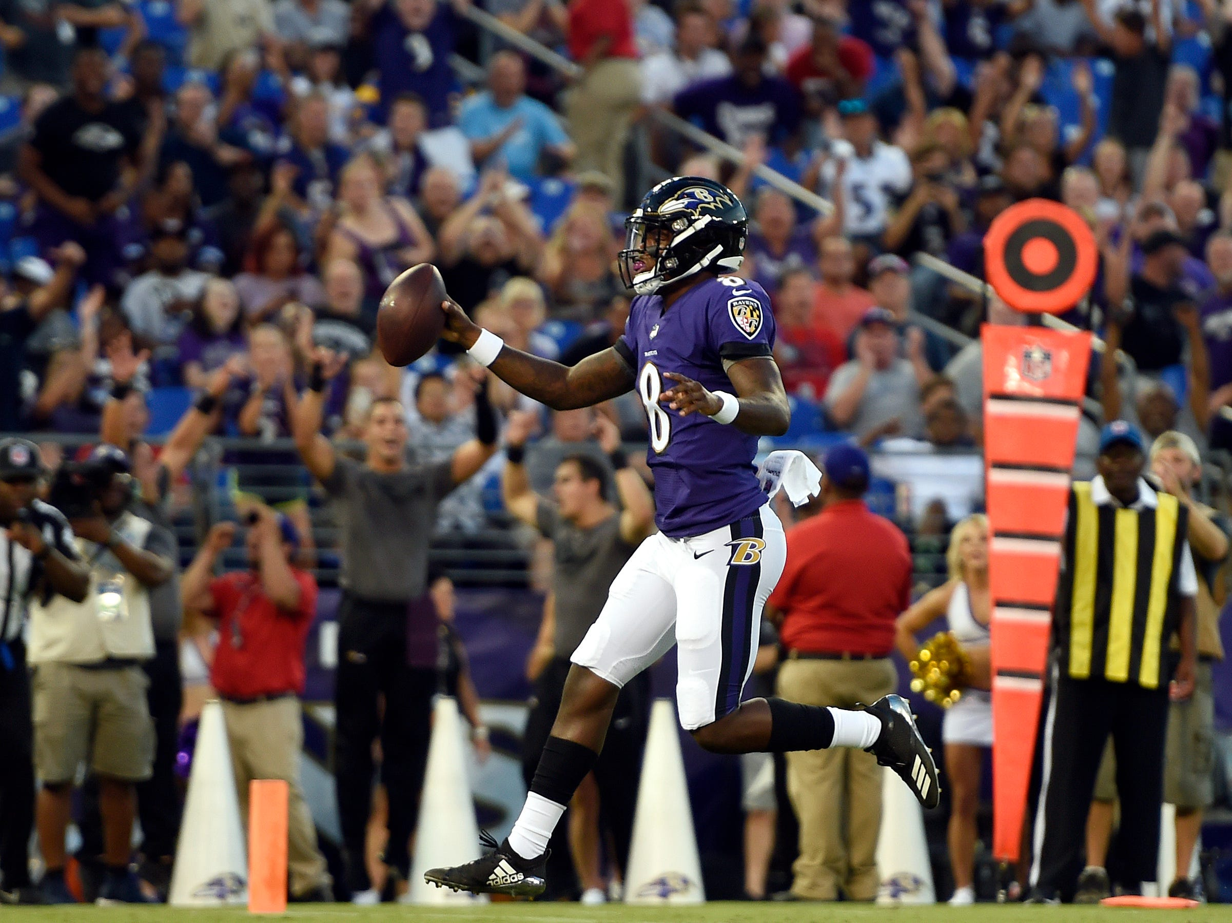 Baltimore Ravens quarterback Lamar Jackson scores a touchdown in the first half of a preseason NFL football game against the Los Angeles Rams, Thursday, Aug. 9, 2018, in Baltimore. (AP Photo/Gail Burton)