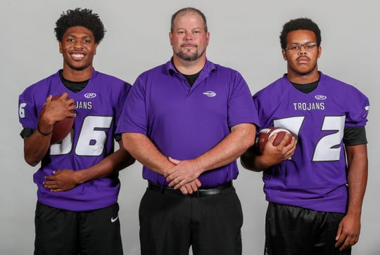 Southern Trojans LEFT TO RIGHT: Montell Livers, senior, linebacker/running back, Mike Gossett, head coach, Tyler Edwards, senior, middle linebacker/offensive tackle.August 7, 2018