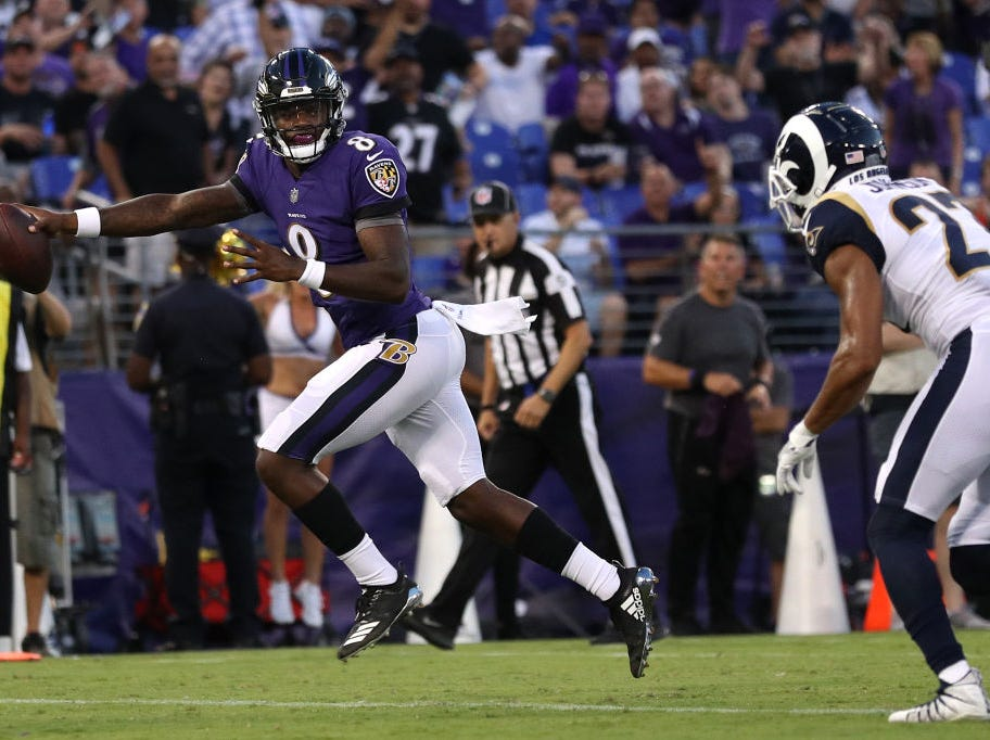 BALTIMORE, MD - AUGUST 09: Lamar Jackson #8 of the Baltimore Ravens rushes to score a touchdown during the first quarter against the Los Angeles Rams during a preseason game at M&T Bank Stadium on August 9, 2018 in Baltimore, Maryland. (Photo by Patrick Smith/Getty Images)
