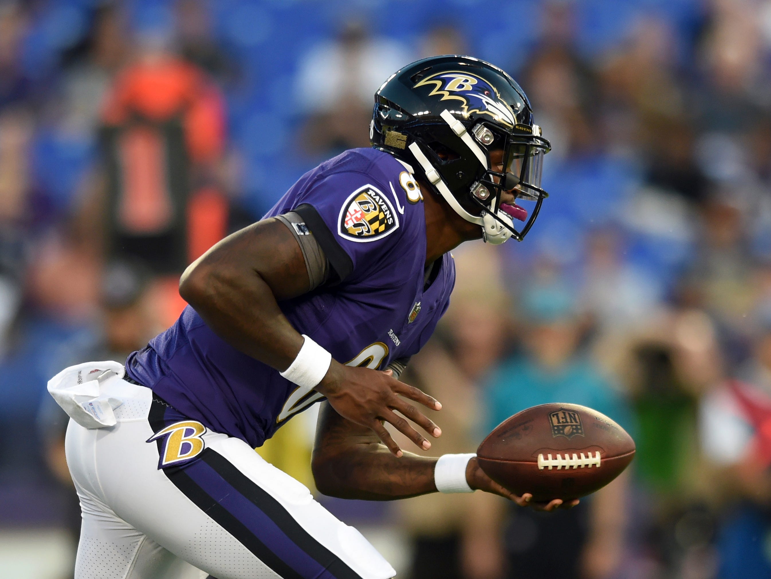 Baltimore Ravens quarterback Lamar Jackson drops back from the line of scrimmage in the first half of a preseason NFL football game against the Los Angeles Rams, Thursday, Aug. 9, 2018, in Baltimore. (AP Photo/Gail Burton)
