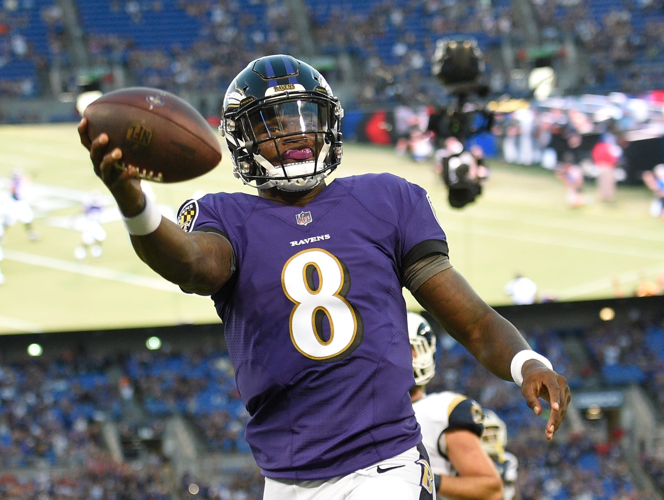Baltimore Ravens quarterback Lamar Jackson celebrates after scoring a touchdown in the first half of a preseason NFL football game against the Los Angeles Rams, Thursday, Aug. 9, 2018, in Baltimore. (AP Photo/Nick Wass)