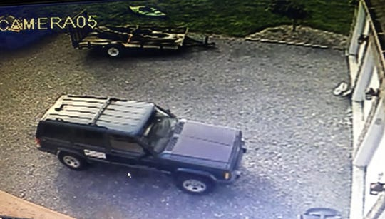 The FBI believes surveillance footage shows a green Jeep Grand Cherokee that was stolen in Kentucky.  S