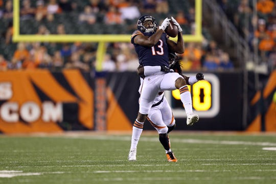 Chicago Bears wide receiver Bennie Fowler (13) makes a catch against Cincinnati Bengals cornerback Davontae Harris (35) in the second half at Paul Brown Stadium.